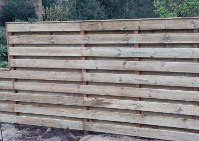 houtenschutting tuin aanleg gooi